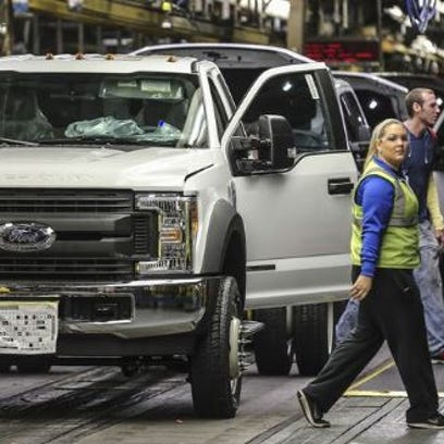 One of the first new Ford Super Duty pickups with an aluminum body rolls down the production line at Ford's Louisville assembly plant