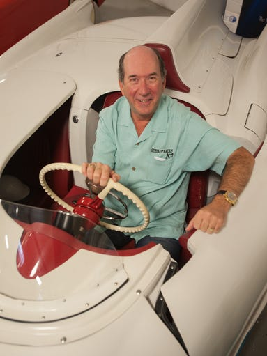 Corvette collector Ken Lingenfelter sits in his 1954