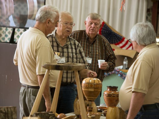 Woodturners talk shop  July 21 during the Artistic Woodturners of Northwest Florida's meeting at Ragon Hall.