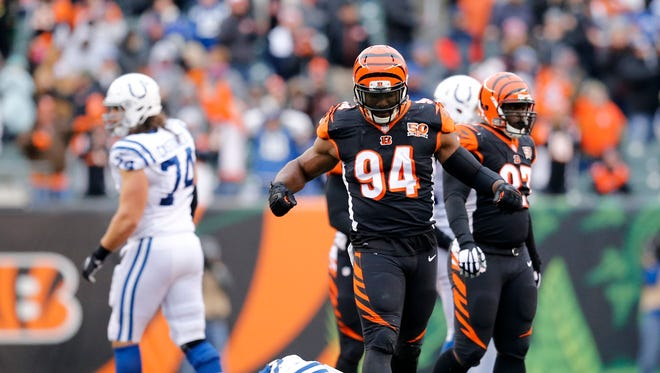Cincinnati Bengals defensive end Chris Smith (94) celebrates after sacking Indianapolis Colts quarterback Jacoby Brissett (7) in the fourth quarter of the NFL Week 8 game between the Cincinnati Bengals and the Indianapolis Colts at Paul Brown Stadium in downtown Cincinnati on Sunday, Oct. 29, 2017.