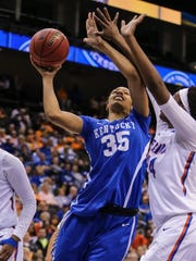 Kentucky forward Alexis Jennings, a Sparkman graduate, shoots the ball between defenders Florida guard Carla Batchelor (32) and center Tyshara Fleming (24), right, during an NCAA college basketball game in the Southeastern Conference women's tournament in Jacksonville, Fla., Friday, March 4, 2016. (AP Photo/Gary McCullough)