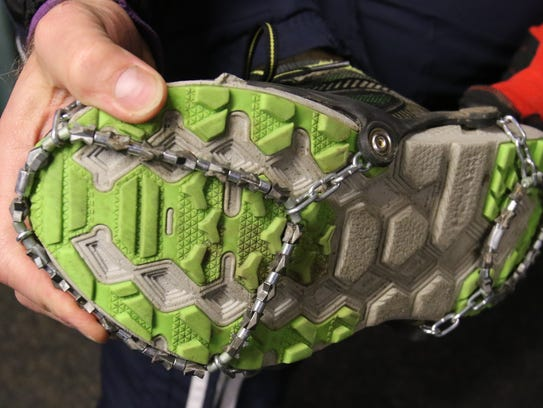Tim Gamroth of Dousman puts the equivalent of tire chains on his running shoes for a Wednesday evening run by the Lapham Peak Trail Runners on Jan. 31. Some will run the Ice Age Trail to Lapham Peak's southern border, while others will stick to trails leading up to Lapham Peak.