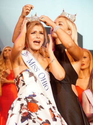 Miss Ohio 2015 Sarah Hider crowns Miss Portsmouth Alice Magoto of Cincinnati as the 2016 Miss Ohio on Saturday night during the Miss Ohio Scholarship Program at the Renaissance Theatre in Mansfield, Ohio.