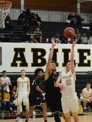Abilene High's Nic Marczynski shoots a floater in the