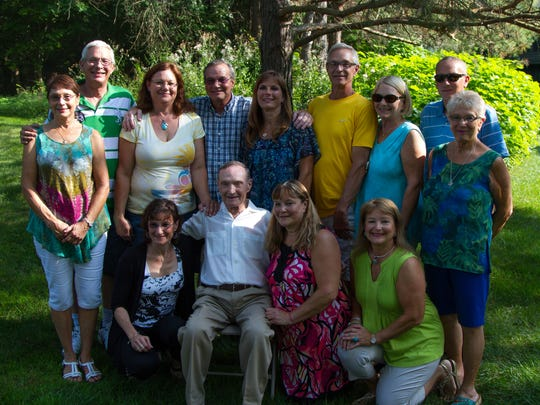 Howard Grider, 92, is surrounded by his 12 children at his 90th birthday party in 2015.