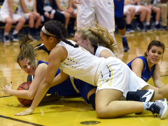Melena Moore secures a loose ball in a pileup on the