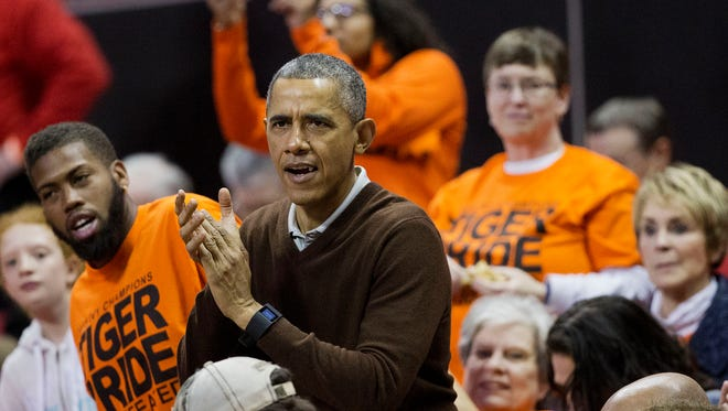 President Barack Obama cheers at the Princeton game against UWGB. Obama's niece, Leslie Robinson, plays for Princeton.