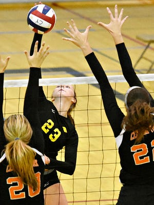 Red Lion's Lauren Enfield, center, had 15 kills and 13 digs Thursday vs. Exeter.