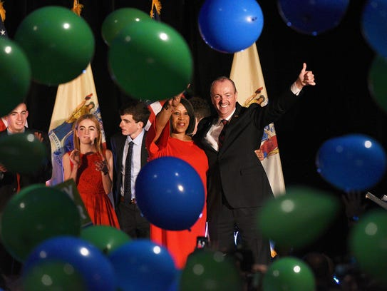 Gov.-elect Phil Murphy and Lt. Gov.-elect Sheila Oliver celebrate their victory with supporters at the Convention Center in Asbury Park after the polls closed on election night, Nov. 7, 2017.