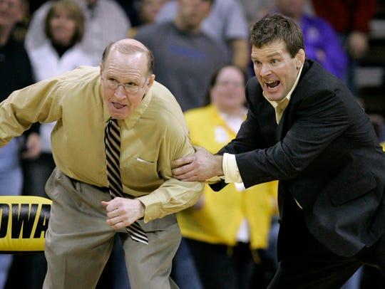 Dan Gable, left, legendary wrestling coach at the University