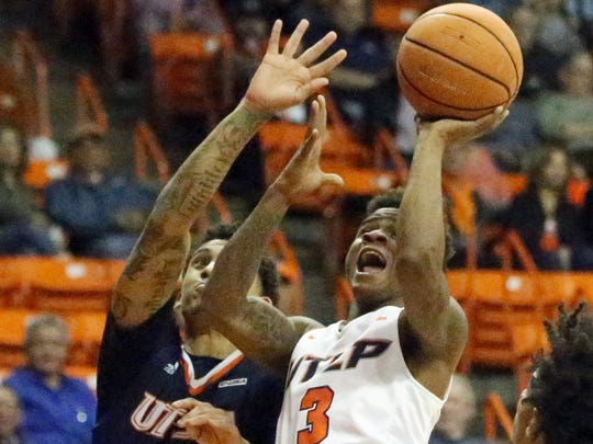 UTEP guard Evan Gilyard, 3, goes for a shot against Deon Lyle, 1, of UTSA on Saturday night.