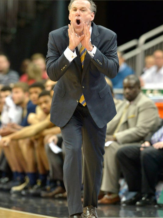 Pittsburgh head coach Jamie Dixon shouts instructions to his team during the first half of an NCAA college basketball game against Louisville, Thursday, Jan. 14, 2016, in Louisville, Ky. (AP Photo/Timothy D. Easley)