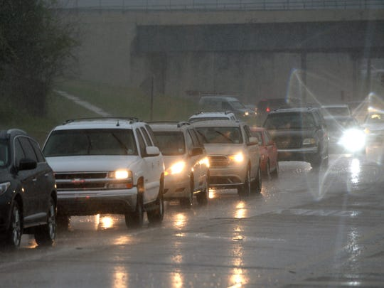 Traffic backs up along Kings Highway as rain begins