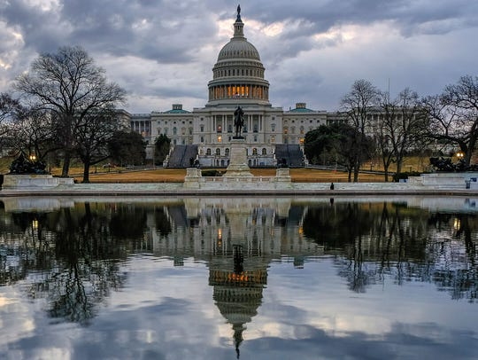 Clouds are reflected in the U.S. Capitol reflecting