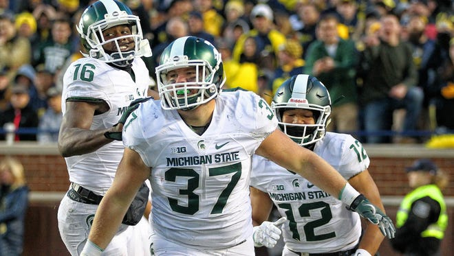 Michigan State players celebrate a touchown in their last-second win at Michigan.