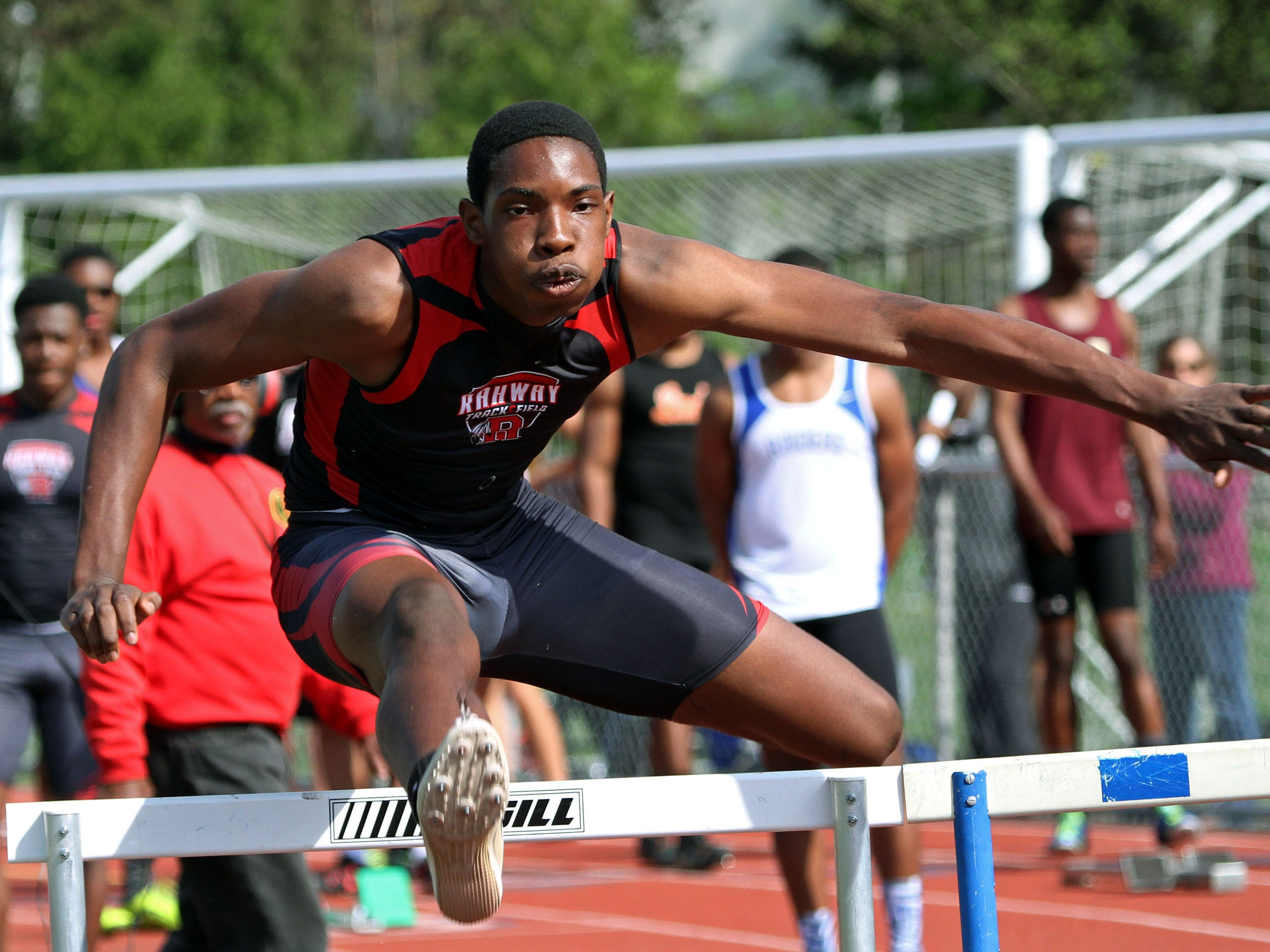 Rahway's Mykelti Thomas runs the first leg for his team in the shuttle hurdles.This is action of the Union County Track and Field Relays.