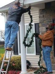 Volunteers decorated disabled veteran Zach Stinson's home Saturday afternoon