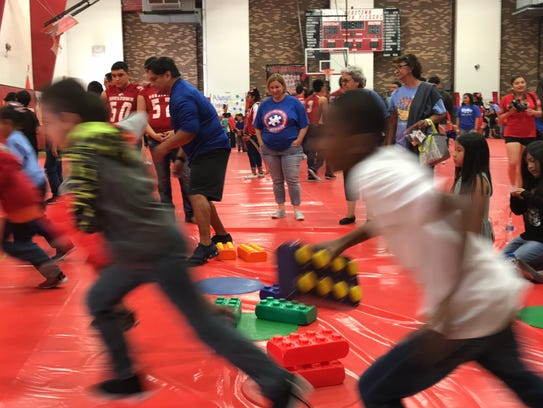 Robstown students race to finish first at the Lego build tournament at the 2nd annual Autism Awareness and Special Olympic Rally.