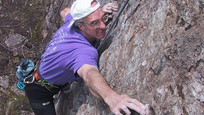 Phil Watts climbing at his namesake crag, Phil's Hill, in Marquette.