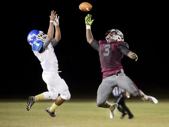 Librety's Alec Long jumps in attempt to make a one-handed interception against Fayette-Ware in the Class 3A playoffs.