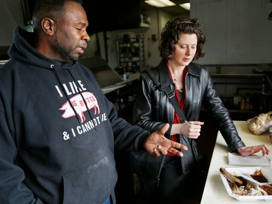 "Darryl ""Mr. Darryl"" Richardson talks about his style of barbecue with Journal & Courier arts and entertainment reporter Domenica Bongiovanni on Thursday, March 19, 2015, at Mr. Darryl's Southern BBQ, 2070 S. 22nd St., Lafayette."