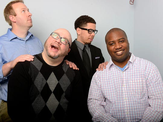 Life's a game to our sports team _ Chris Solari, (front left), Brian Calloway, Graham Couch (back left) and James L. Edwards III.