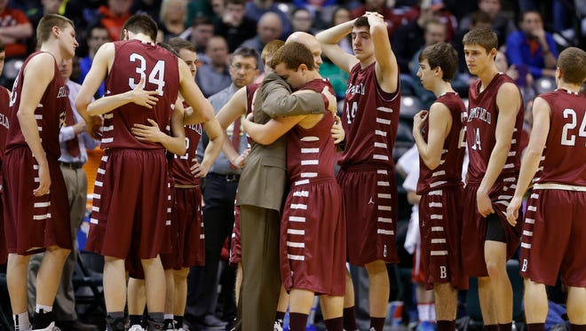 Bloomfield High School's Eli Combs hugs coach Matt Britton following a 64-45 loss to Liberty Christian in the the Indiana Class A state championship basketball game in Indianapolis, Saturday, March 26, 2016.