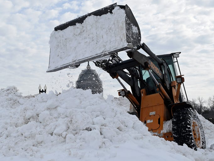 Snow is piled up near Capitol Hill in Washington after