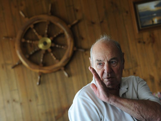 "Lewis ""Lew"" Wright points motions towards the Chincoteague"