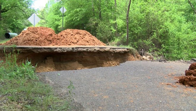 A collapsed portion of Mount Olivet Road in Panola County, Miss.