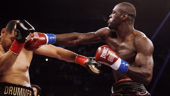 Deontay Wilder retains his WBC heavyweight championship with a knockout victory over Eric Molina