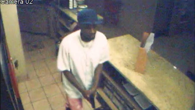 Surveillance video shows a man allegedly robbing the Quality Inn in Columbus, Miss.