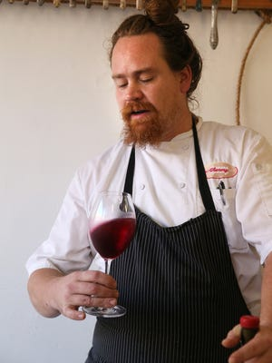 Christopher Bates, shown at his FLX Table restaurant in Geneva, focuses on red wines as winemaker at Element Winery.