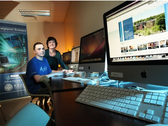 Kean University Computer Science Professor Patricia Morreale, pictured here with a student, has been selected by the Mathematics and Computer Science Division of the Council on Undergraduate Research (CUR) as a 2016 Faculty Mentoring Award winner.