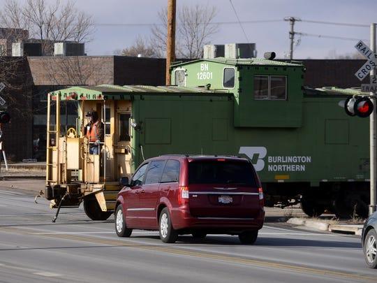 File photo: Traffic waits as a BNSF train crosses Sixth Street in 2013.