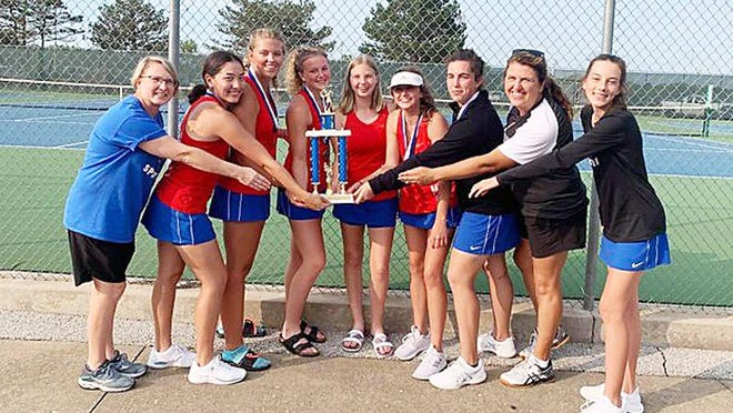 Moberly Lady Spartans tennis team celebrate Saturday for winning the Lady Pirate Open tournament held at Boonville High School. Members shown are assistant coach Bonita Smith, sophomore Lilly Tagai, seniors Liz Latson, Ashton Martin, Maggie Smith, Cheyenne Lea and Jadyn Davidson, head coach Melissa Davidson, and sophomore Hallie Kroner.