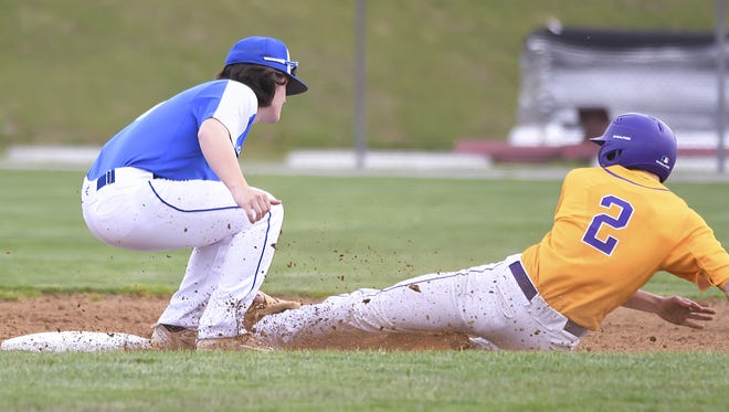 Highlands shortstop Ethan Kavanagh (left) tags out Gavin Peters (right) of the Camels at Campbell County High School, April 26, 2018