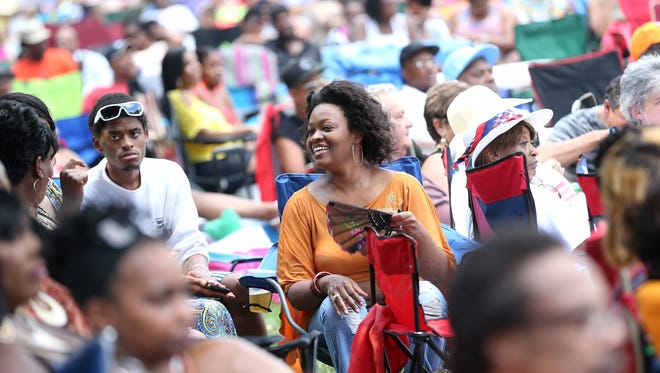 Angie Gore smiles during the 2013 Indiana Black Expo Summer Celebration concert at American Legion Mall.