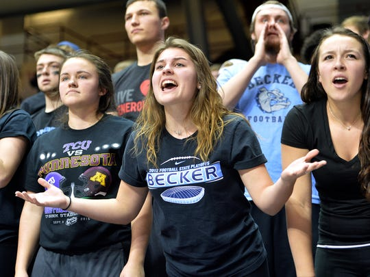 Becker supporters question a call during the second half of the Class 3A girls basketball tournament semifinal game Wednesday at the University of Minnesota's Williams Arena in Minneapolis.
