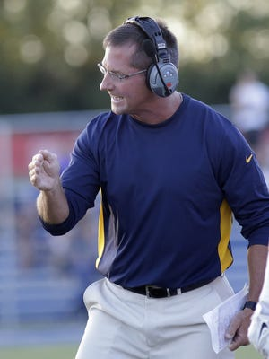 Moeller head coach John Rodenberg reacts during the Crusaders' win against St. Xavier on Friday.