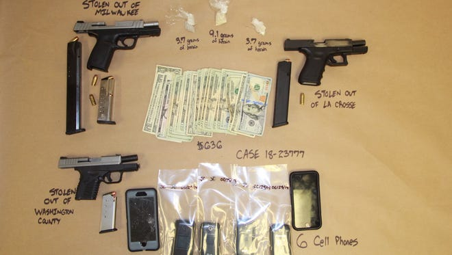 Guns and drugs were seized during a drug deal arranged with an undercover officer.