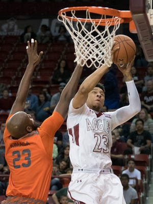 New Mexico State's Zach Lofton gets past UTRGV's Dan Kimsa for two points Saturday afternoon at the Pan American Center.
