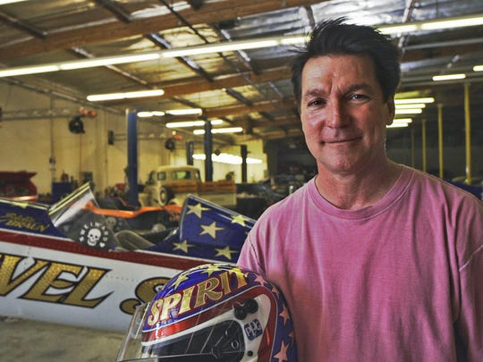 In this July 2016 photo provided by Weiward, Eddie Braun poses for a photo at a storage facility in Chatsworth, Calif. Fueled by the memory of the late daredevil Evel Knievel, Hollywood stuntman Braun plans to strap into a steam-powered rocket cycle on Sept. 17, for his most death-defying role yet. (Weiward via AP)