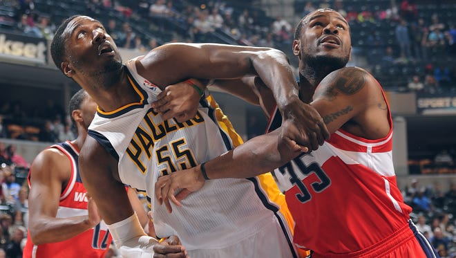 Indiana Pacers Roy Hibbert,left, and Washington Wizards Trevor Booker,right, fight for position under the basket in the first half of their game Saturday evening at Bankers Life Fieldhouse.