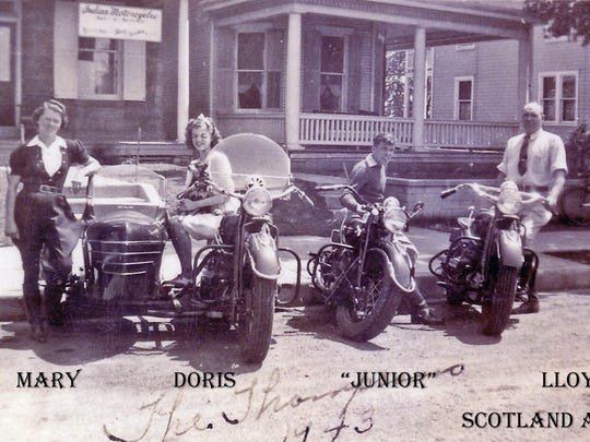 The Thompson family with their Indian Motorcycles on Scotland Avenue in 1943.  You can see the Indian Motorcycle banner hanging on the front porch. It was family affair.