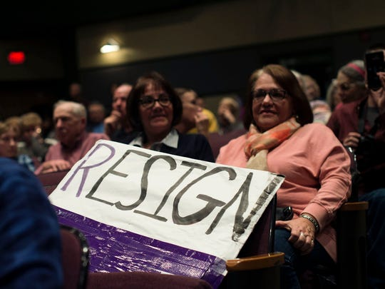 "A sign reading ""RESIGN"" sits in the audience during the Warren City Council meeting on Tuesday, Jan. 24, 2017 at the Community Center in Warren."