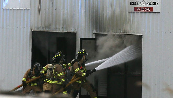 A commercial fire burns near the mixmaster on 46th Ave Monday afternoon Monday, Nov. 10, 2014.