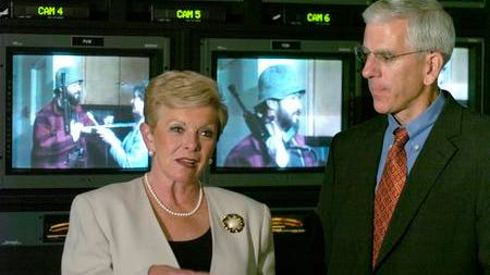 Elaine Green talked in 2005 about being taken hostage in 1980 with Tom McKee and other Channel 9 staffers by gunman James Hoskins (on TV behind her).