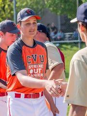 Champlain Valley sophomore Storm Rushford shakes hands