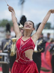 A twirler for the Noblesville High School band shows